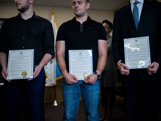 Rutgers graduates Matteo Resanovic, from left, Jonathan Perez-Gaytan and Corey Zytko are recognized Tuesday, June 12, 2018 at Mayor Frank Moran's office in Camden, N.J. The three of them, as well as three other Rutgers students rescued a man from a house fire in March 2018.