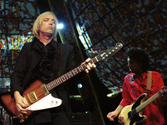 Tom Petty, left, and The Heartbreakers' bassist Howie