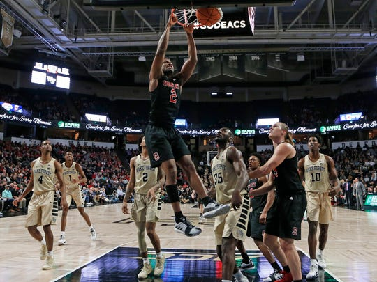 North Carolina State's Torin Dorn (2) dunks against Wake Forest during the first half of an NCAA college basketball game in Winston-Salem, N.C., Tuesday, Jan. 15, 2019. (AP Photo/Chuck Burton)