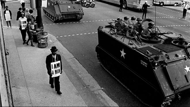 Sanitation worker Otto Carnes participates in a march on March 29, 1968. The city was taking no chance on a repeat of the previous day's violence. National Guardsmen in armored personnel carriers equipped with 50-caliber machine guns escorted marchers.