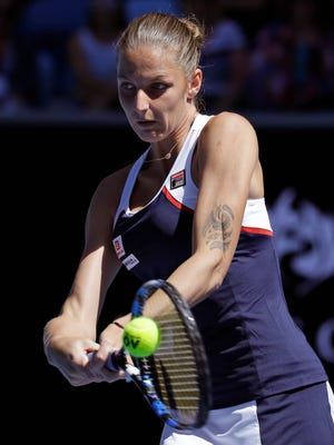 Karolina Pliskova of the Czech Republic makes a backhand return to Russia's Anna Blinkova during their second round match at the Australian Open tennis championships in Melbourne, Australia, Thursday, Jan. 19, 2017.