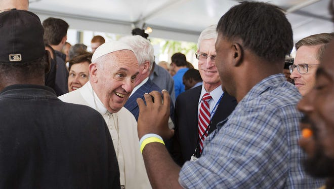 Pope Francis greets the public during a visit to Catholic Charities of the Archdiocese of Washington Thursday.