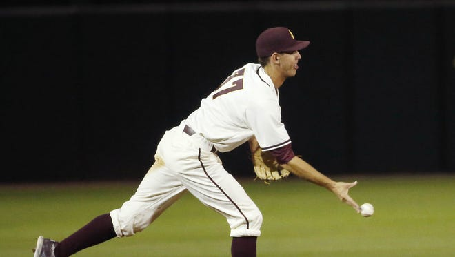 ASU shortstop Colby Woodmansee tosses to second base to begin a double play against Arizona to end the fourth inning at Phoenix Municipal Stadium April 12, 2016.