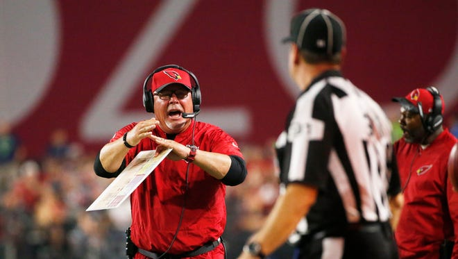 Arizona Cardinals head coach Bruce Arians calls timeout during a game against the Seahawks.