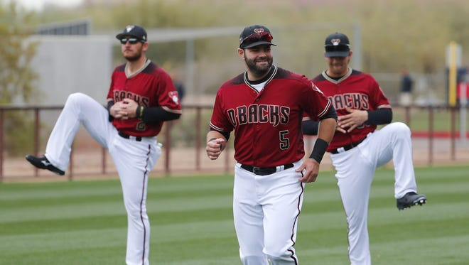 Diamondbacks catcher Alex Avila (5) warms up during the first day of workouts for pitchers and catchers at Salt River Fields on the Salt River Pima-Maricopa Indian Reservation February 14, 2018.