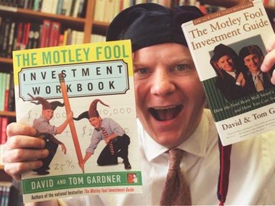 Tom gardner is shown here with copies of two of the motley fool
