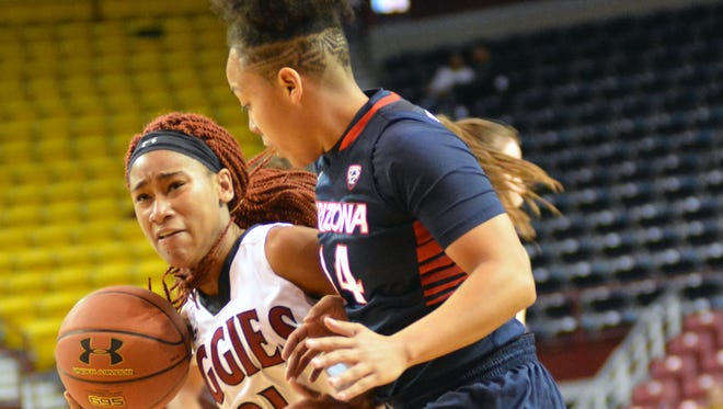 New Mexico State's Tamera William drives down the lane against a Arizona's Malena Washington as the Aggies took on the Wildcats Sunday afternoon at the Pan American Center.