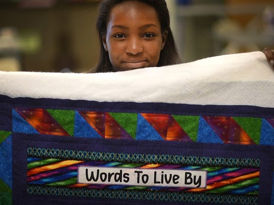 "Cedar Crest Middle School students participating in ""Falcons Care"" made quilts that will be donated to Domestic Violence Intervention of Lebanon County. Kyreana Barrett made a motivational quilt during the outreach project."