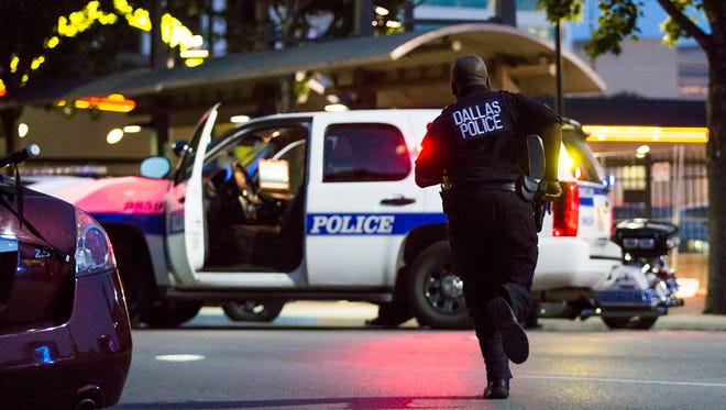 Dallas police respond after shots were fired at a Black Lives Matter rally in downtown Dallas on Thursday, July 7, 2016.