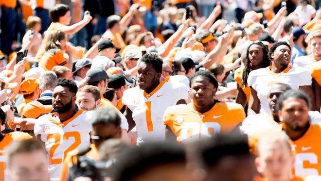 Tennessee players walk in the Vol Walk during the Tennessee Volunteers Orange & White spring game at Neyland Stadium in Knoxville, Tennessee on Saturday, April 21, 2018.