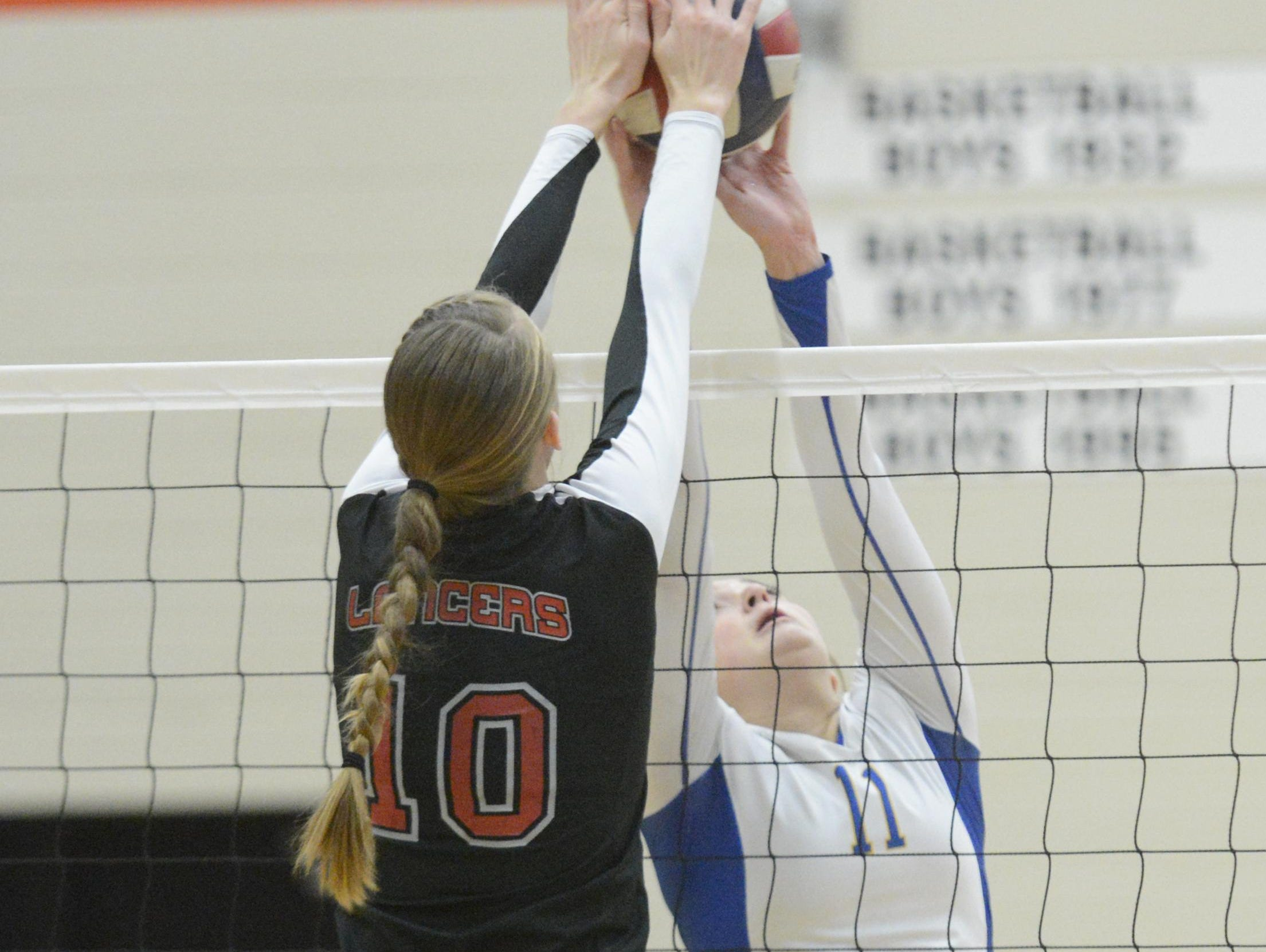 Manitowoc Lutheran's Lindsay Engelbrecht (10) goes for a block against Howards Grove's Taylor Bubolz during a game at the WIAA Division 3 Sectional Semifinals at Reedsville Middle School on Thursday, Oct. 29 in Reedsville. The Lancers fell to the Tigers 3-0.