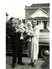 George Simonka and his wife, June, hold twin baby daughters