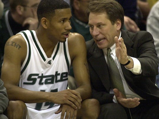 MSU Head coach Tom Izzo talks with Charlie Bell during a game against Purdue in 2000.
