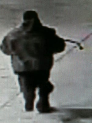 Dover police are looking for this man who they say stole a cash register from Dover Express.