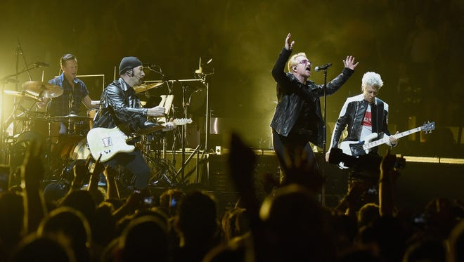 The Edge, Larry Mullen Jr., Bono and Adam Clayton during U2's 'iNNOCENCE + eXPERIENCE' tour at Madison Square Garden on July 26, 2015 in New York.