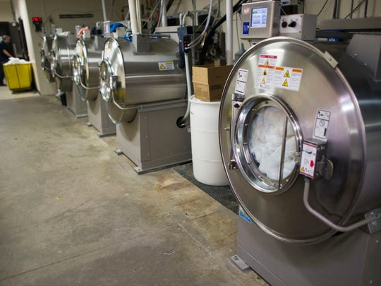 Giant industrial washing machines inside the Omni Severin Hotel, the day before the NCAA Men's Basketball Final Four, Indianapolis, April, 3, 2015.