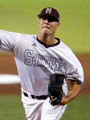 Mississippi State pitcher Zac Houston throws against