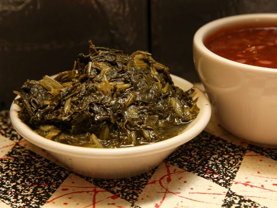Turnip greens and homemade baked beans are served at Memphis Pig Out in Atlantic Highlands.