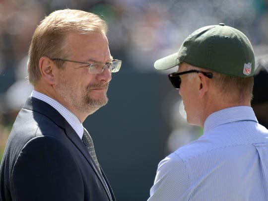 New York Jets general manager Mike Maccagnan, left, speaks with owner Christopher Wold Johnson before an NFL football game against the Miami Dolphins Sunday, Sept. 24, 2017, in East Rutherford, N.J. (AP Photo/Bill Kostroun)
