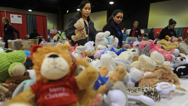 Hundreds of people shopped for toys for Christmas at the annual Salvation Army's Christmas Assistance Distribution of toys, books and food baskets to children and their families in need at Shopko HallDecember 22, 2015.