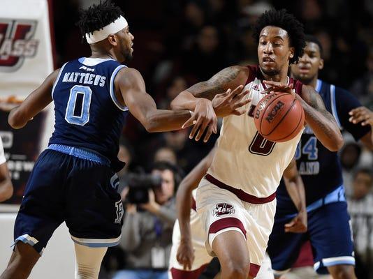 Massachusetts' Malik Hines, right, steals the ball from Rhode Island's E.C. Matthews, left, during the first half an NCAA college basketball game, Tuesday, Jan. 30, 2018, in Amherst, Mass. (AP Photo/Jessica Hill)