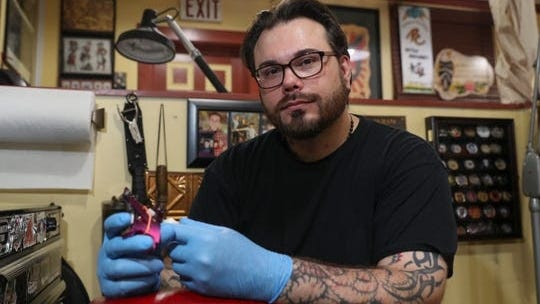 "Mick O'Herien, owner of Revolution Tattoo Co. in Pearl River, is photographed on Tuesday, June 9. O'Herien said tattoo artists had been ""sold this bill of goods"" from the state, given how they weren't part of Phase 2, which included nail salons and barbers."