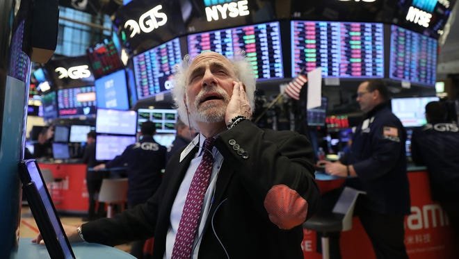 Traders work on the floor of the New York Stock Exchange (NYSE) moments before the Closing Bell on February 8, 2018 in New York City. As Wall Street continues to worry about future inflation and rising interest rates, the Dow Jones Industrial Average fell over 1,000 points for the second time this week.