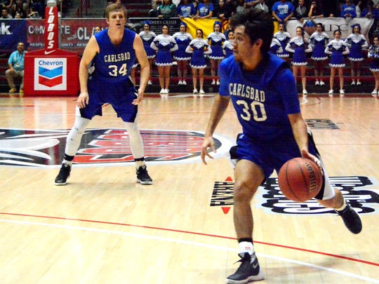 Carlsbad senior point guard Malachi Calderon attacks the basket in Thursday's U.S. Bank 6A state tournament semifinals game against Onate. Calderon is one of six seniors on this year's team.