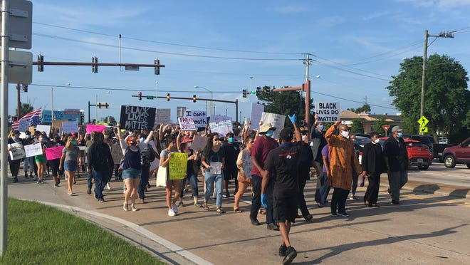 Protesters walk down U.S. 1 in St. Augustine on Monday, June 1, 2020. The death of George Floyd, an African-American man who died in police custody, has sparked protests across the country.