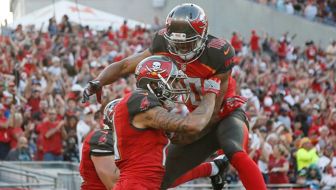 Tampa Bay Buccaneers wide receiver Cecil Shorts (top) celebrates with wide receiver Mike Evans (13) his touchdown during the first quarter of an NFL football game against the Seattle Seahawks at Raymond James Stadium.