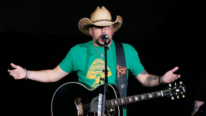 Jason Aldean addresses the crowd about the shooting in Las Vegas during his concert in Tulsa, Okla., Thursday, Oct. 12, 2017.