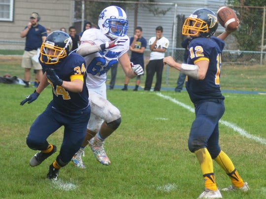 Saddle Brook quarterback Kevin Daly (12) throwing a