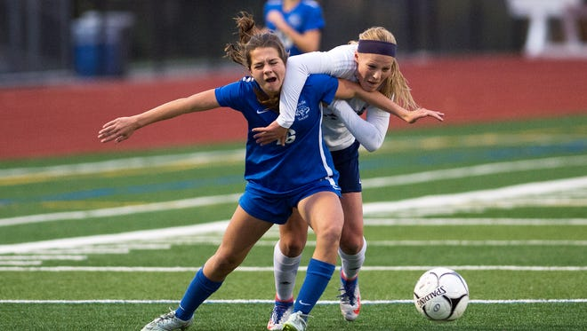 Bronxville defender Clio Dakolis, left, fights for position with Chenango Forks forward Riley Peterson during the first half of the Class B sub-regional on Tuesday, Nov. 1, 2016.