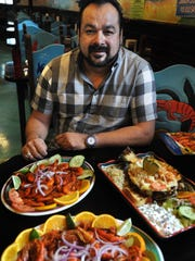 Owner Arnulfo Ramirez shows off some of the specialities