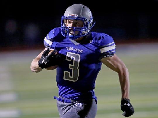 Southwest High School's Kaleb Keener sprints into the