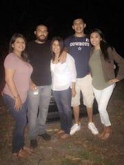Juana Rivas Hernandez, center, with her four children, Christina Hernandez, from left, Leobardo Hernandez, Jesus Hernandez and Daisy Hernandez.
