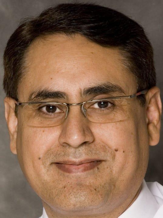 Dr. Arvinder Bhinder.jpg
