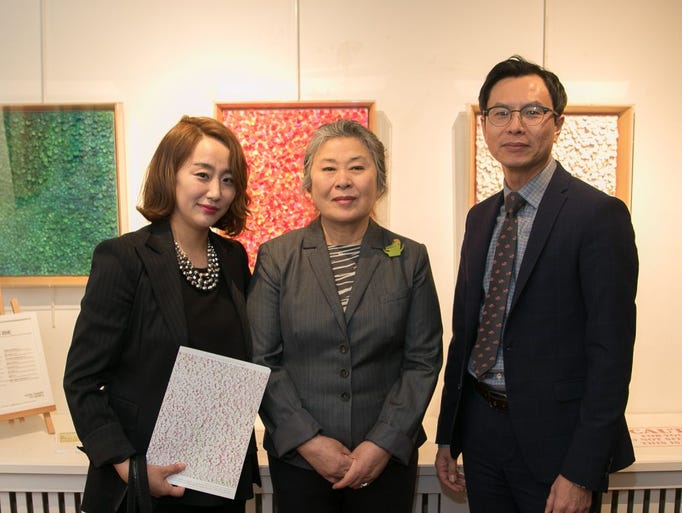 Sandy and William Kim with Artist Sung Hee Cho. An
