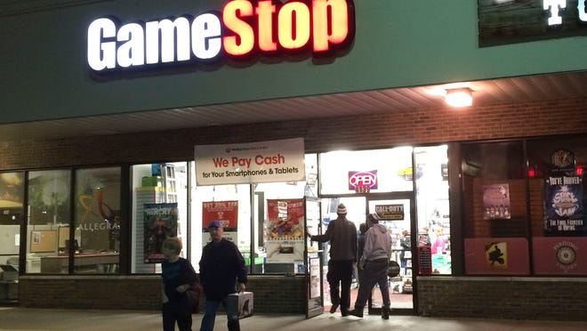 People walk in and out of GameStop in Fort Gratiot after the 12:01 am Monday release of Call of Duty: Advanced Warfare.