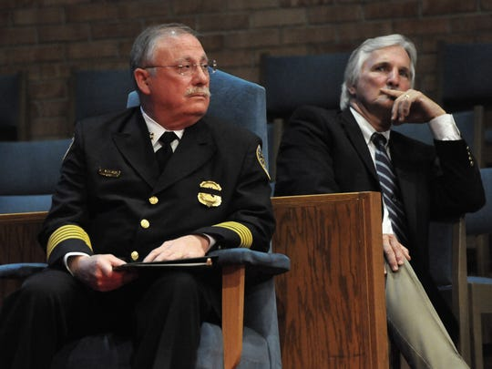 An emotional Chief Steve Anderson and former police commander Robert Nash, who recently lost his son, listen during the ceremony.