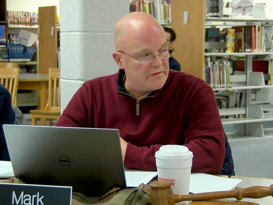 Burlington School Board Chairman Mark Porter reads a statement in which he accused fellow board member Jeffrey Wick of racism during a board meeting on Tuesday, January 23, 2018.