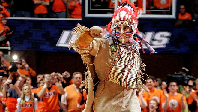 University of Illinois mascot Chief Illiniwek performs for the last time on Feb. 21, 2007. Illinois no longer uses the mascot but did keep the Fighting Illini name.