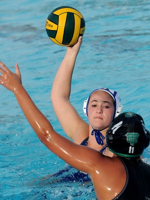 Agoura's Kaitlin Gardhouse takes a shot on goal as Joy Hong (11) defends for Thousand Oaks in a match at Thousand Oaks. Agoura won by a score of 18-5 to extend its league win streak to 142.