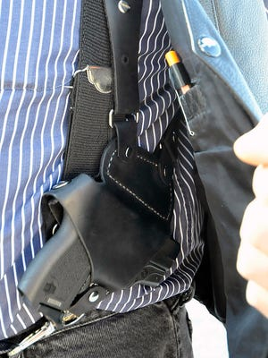 FILE - In this Jan. 2, 2012 file photo, a small handgun is seen under a vest in High Point, N.C. Dealing a blow to gun supporters, a federal appeals court ruled Thursday, June 9, 2016, that Americans do not have a constitutional right to carry concealed weapons in public.  (Sonny Hedgecock/The Enterprise via AP, File) MANDATORY CREDIT