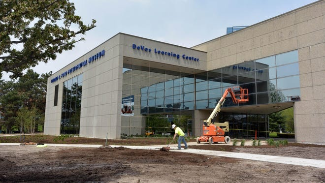 FILE - Inn a May 16, 2016 file photo, The DeVos Learning Center is almost completed on the side of the Gerald R. Ford Presidential Museum in Grand Rapids, Mich. The museum reopens June 7 after being closed since last fall for renovations. (Dale G. Young/The Detroit News via AP, File)