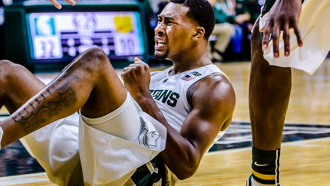 Javon Bess of MSU celebrates his bucket and a foul by an Arkansas-Pine Bluff player Friday in East Lansing.