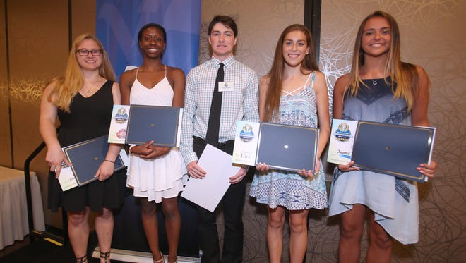 Scholarship winners Julia Wojciechowski of North Rockland, left, Imani Solan of Suffern, Kevin Murphy of Pearl River, Kate Zendell of Suffern and Madison McGrath of Albertus Magnus at The Journal News 2014-2015 Rockland Scholar-Athlete awards dinner at the Crowne Plaza Suffern June 17, 2015.