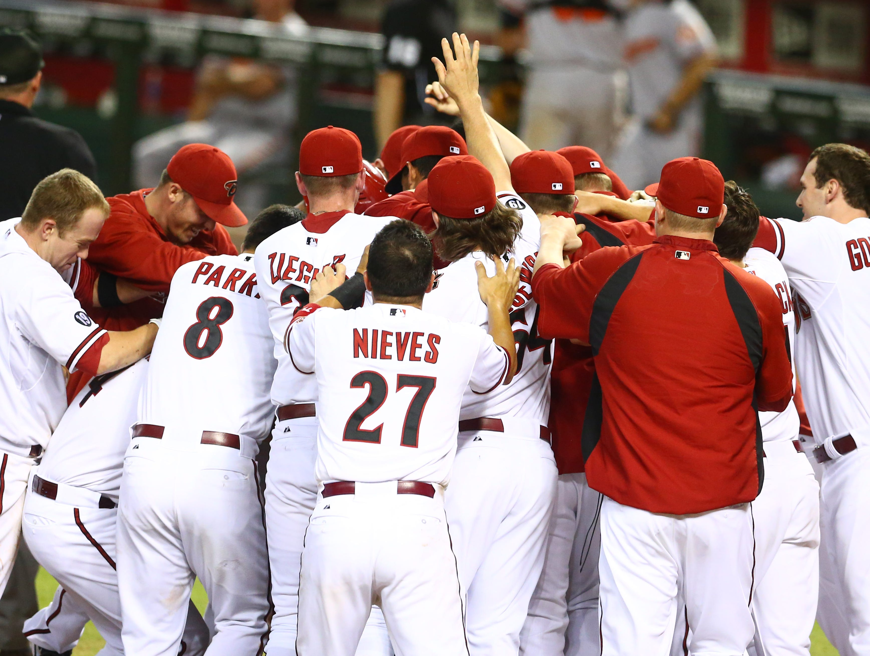 Aug. 12: Arizona Diamondbacks outfielder Adam Eaton is congratulated by teammates after hitting a walk-off home run against the Baltimore Orioles.