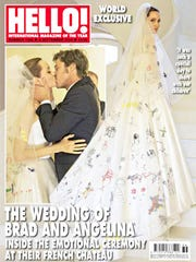 "Angelina Jolie wedding photo on the cover of ""Hello!"" magazine."