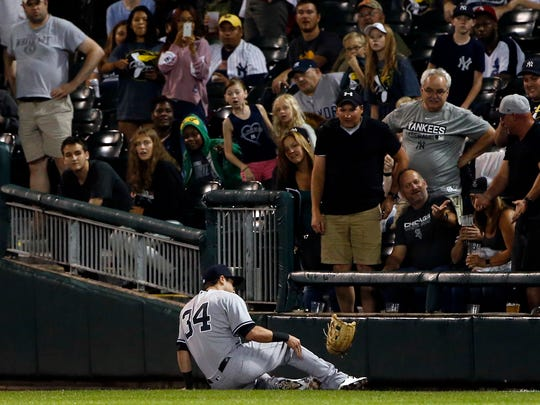 New York Yankees' Dustin Fowler reacts after suffering an injury during the first inning of the team's baseball game against the Chicago White Sox on Thursday, June 29, 2017, in Chicago.
